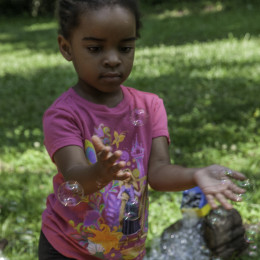 a young visitor has fun at the Davidson-Arabia Mountain Nature Preserve