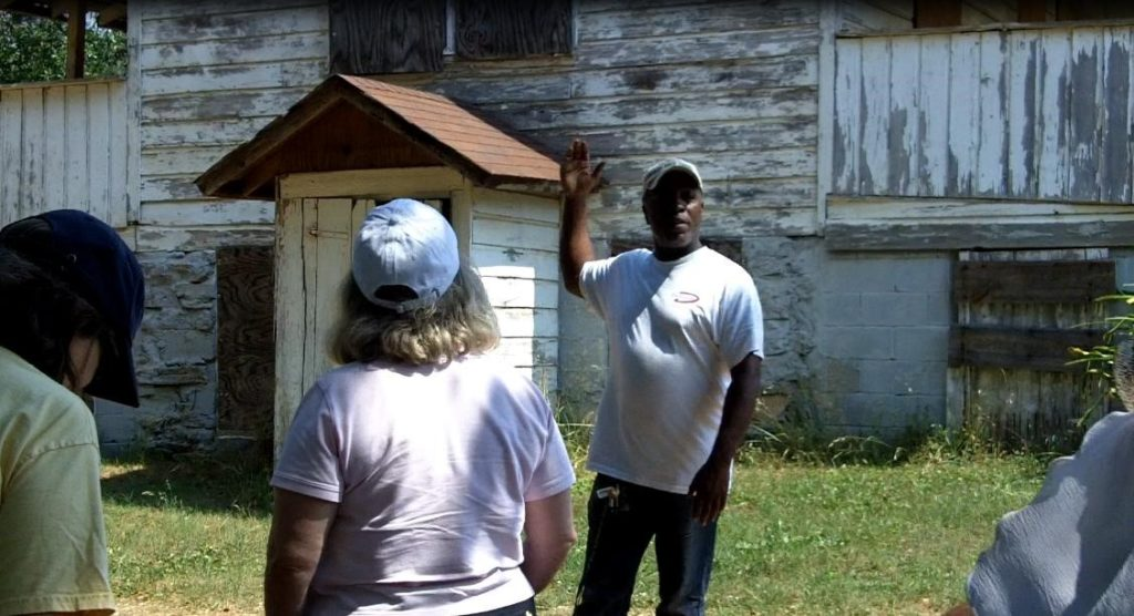 Johnny Waits of the Flat Rock Archives leading visitors on an educational tour of the Lyon Homestead. One of the oldest homesteads in the area, it is also the site where some Flat Rock founders and citizens were enslaved.