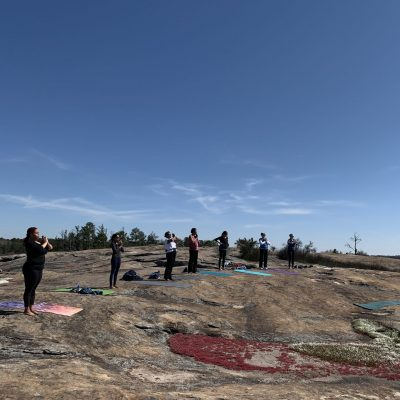 people on mountain doing yoga