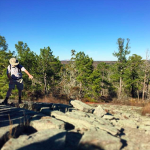 Ranger Robby showing some of the natural wonders of Panola Mountain