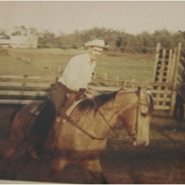 Mr. Vaughters Riding With His Farmhouse in the Background